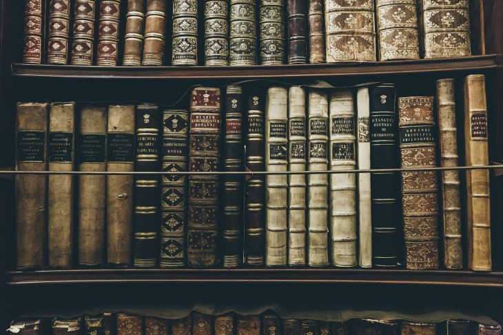 Bookcase of old books with beautiful spines