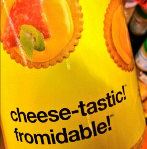 "Edible product with the words ""cheese-tastic!"" and ""fromidable!"" on packaging. ""Fromidable!"" play on words ""fromage"" (cheese in French) and ""formidable!"""