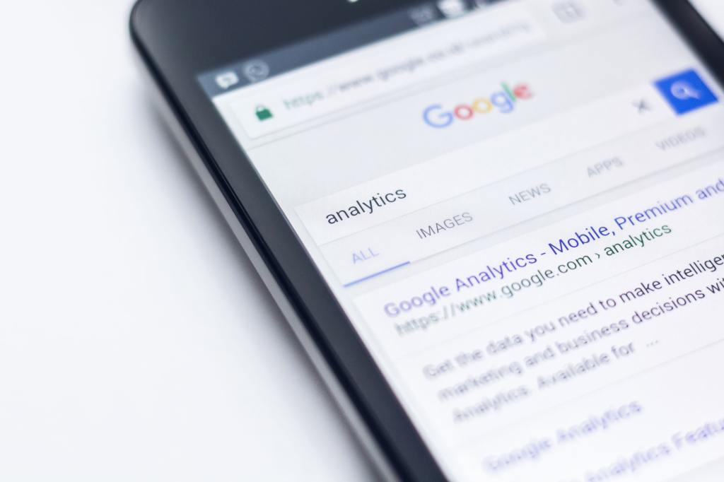 "Smartphone showing Google Search page with results from entering the keyword ""analytics"""