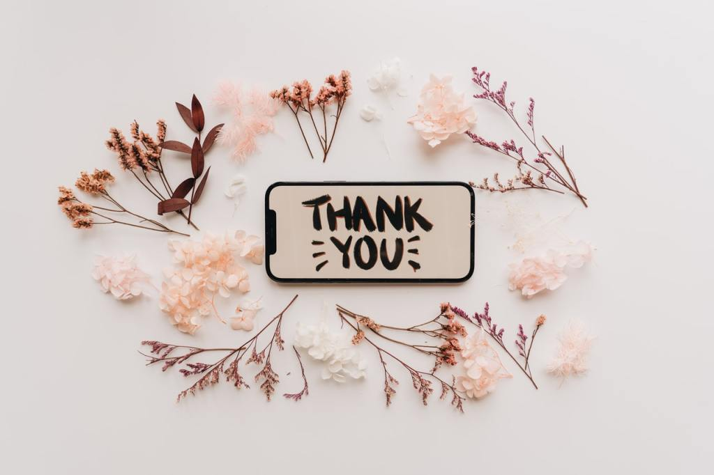 """A photo with a """"thank you"""" message displayed on a mobile phone."""